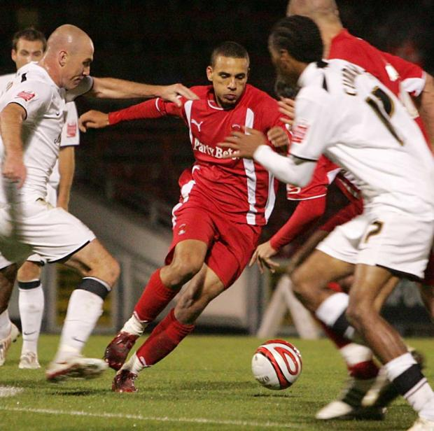 Orient's Dean Morgan looks to find a way through against the MK Dons