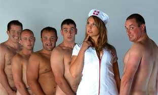 This Is Local London: Good sports: Emily the nurse with the rugby team at a photo shoot