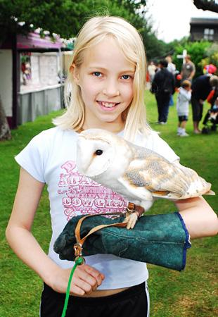 Megan OMahoney with Fleur, a barn owl, during an open day at Wildlife Aid's current site