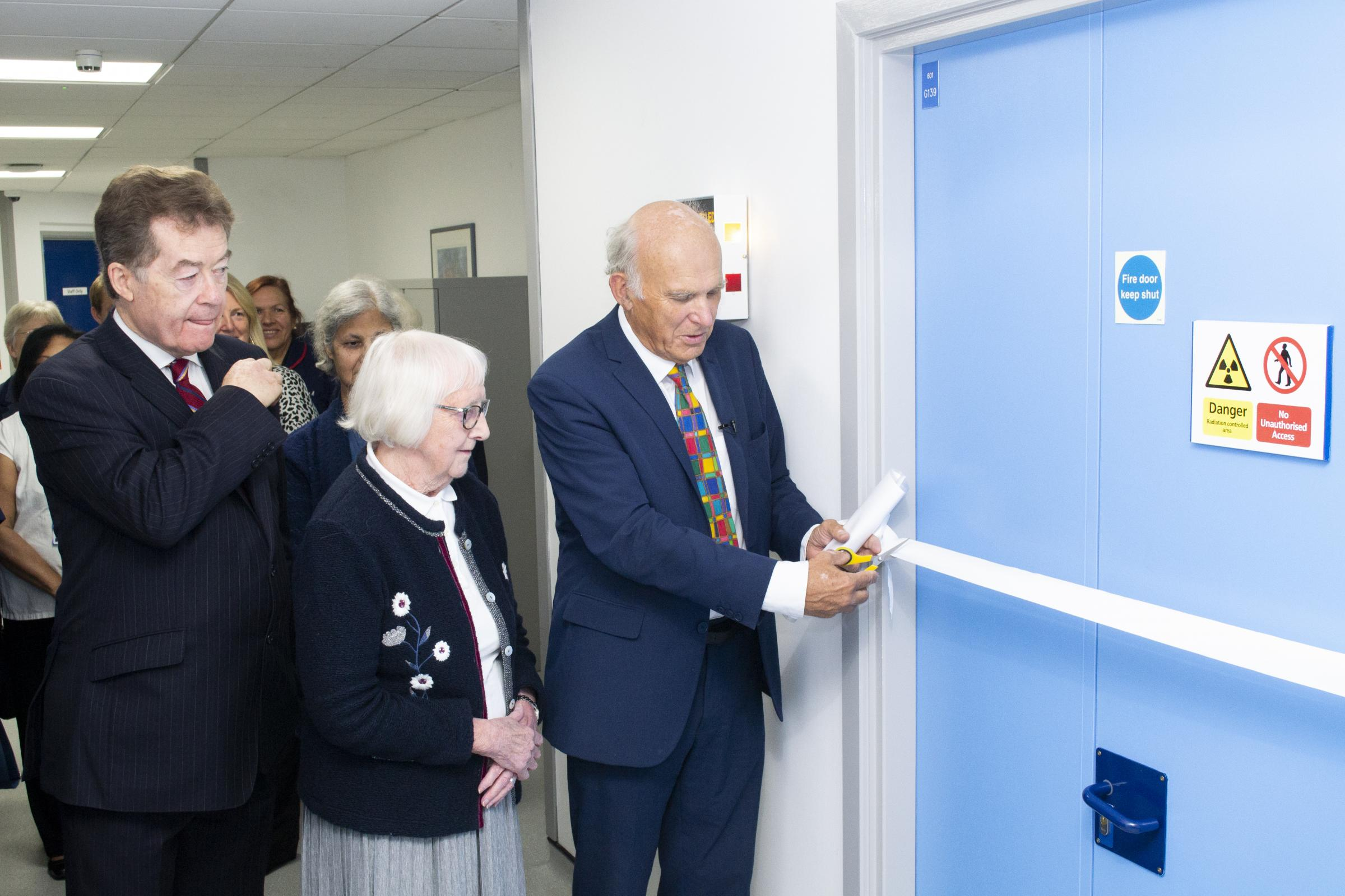 Vince Cable cutting the ribbon.