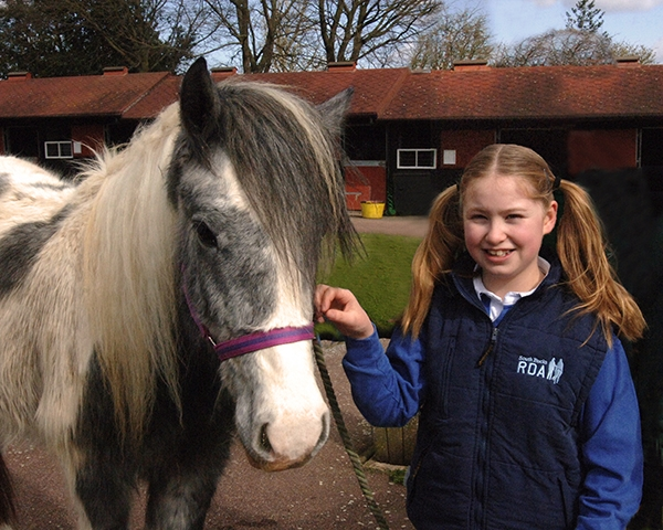 Katy Roberts with Disney, one of the rescued horses now at the Horse Trust