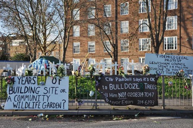 A protest on the green next to the Tidemill garden saw white crosses representing the felled trees.