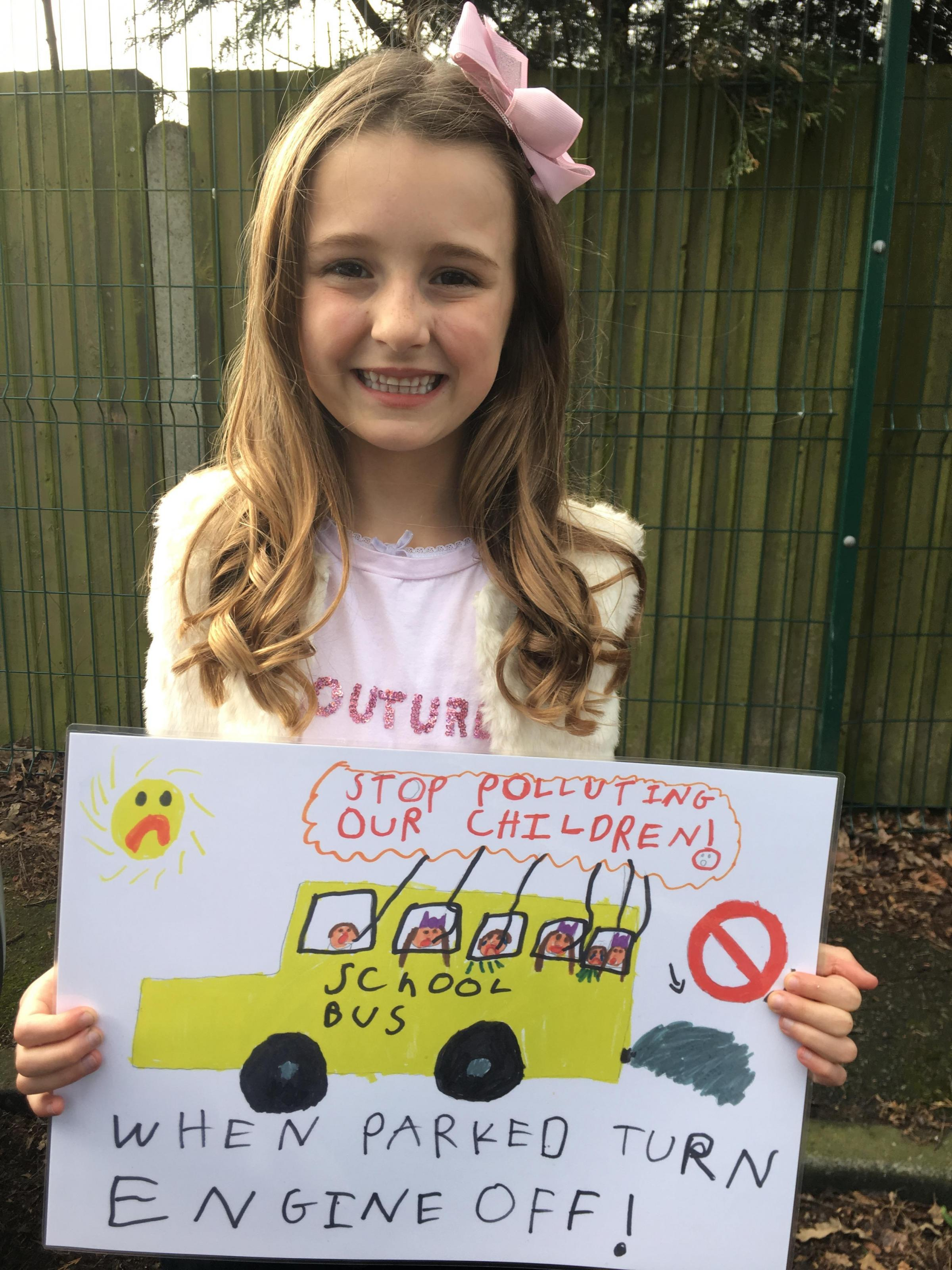 Bella, seven, designs anti-idling posters
