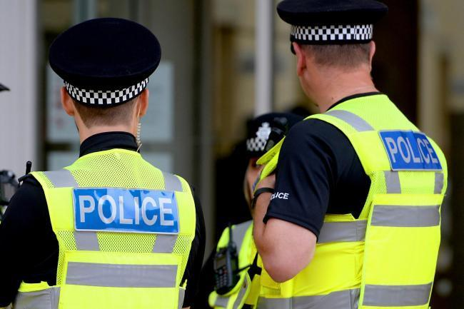 Police officers arrest man on suspicion of burglary offences