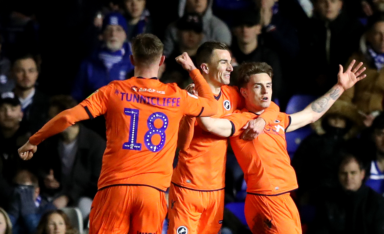 Ben Thompson celebrating with Jed Wallace (middle) and Ryan Tunnicliffe. Photo: PA
