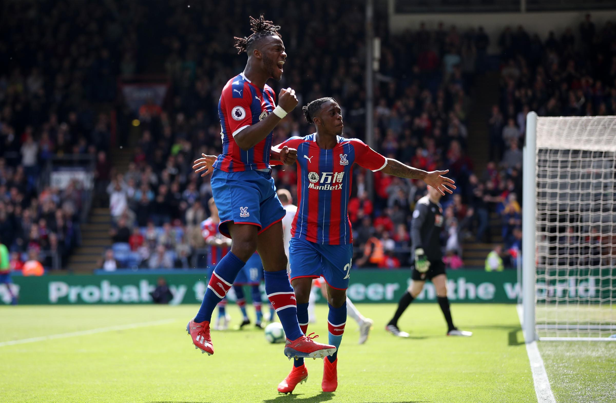 Crystal Palace's Michy Batshuayi celebrates with team mate Aaron Wan-Bissaka after he scores to put his side 2-0 up during the Premier League match at Selhurst Park, London.