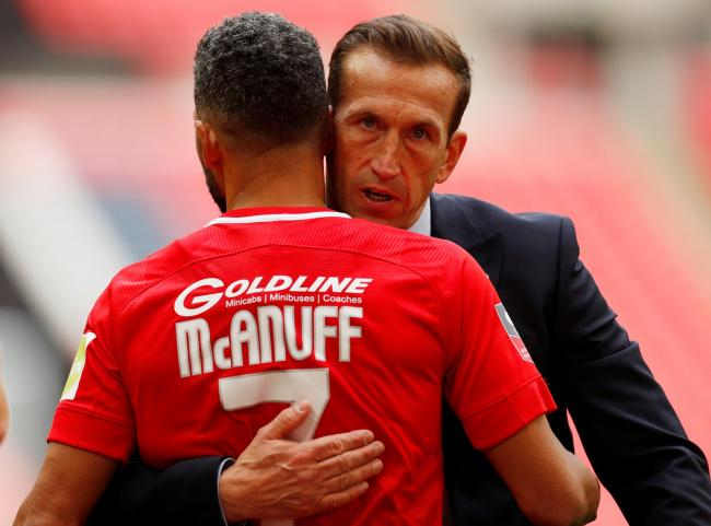 Jobi McAnuff and Justin Edinburgh after the FA Trophy final against AFC Fylde. Picture: Action Images