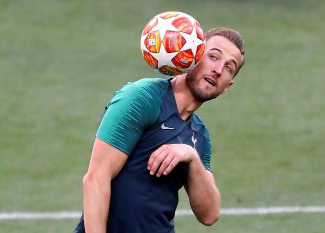 Eyes on the ball: Harry Kane training in Madrid tonight. Picture: Action Images