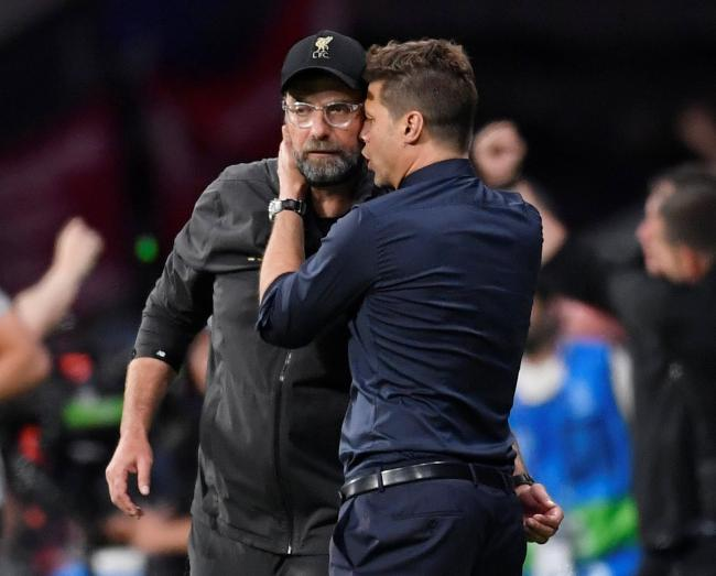 Mauricio Pochettino congratulates Jurgen Klopp after Spurs' defeat in Madrid. Picture: Action Images