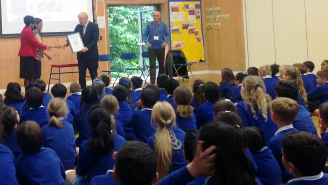 All yours: Boris hands the Platinum Award to Hermitage School