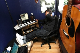 Music composer and producer Shahid Khan in his music studio.